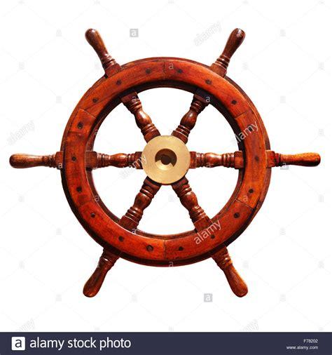 old boat steering wheel old boat steering wheel on a white background stock photo