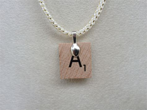 scrabble pendants scrabble tile pendant necklace roller coaster