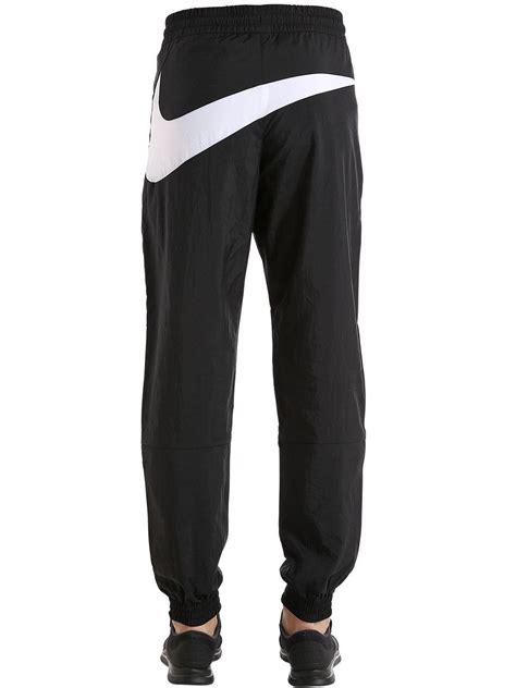 nike logo waveguide lyst nike vaporwave swoosh woven track pants in black
