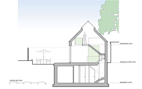 what is the mezzanine section giles pike architects completes timber clad house for a