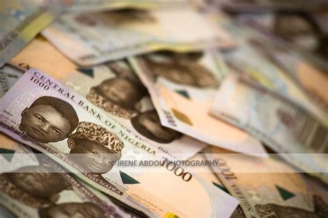 naira hits record     dollar