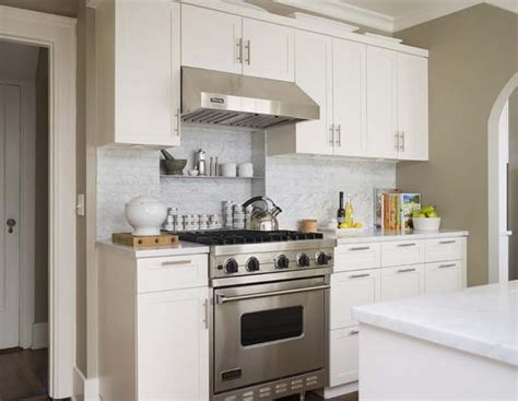 small white kitchen with steel hood cooktop shelf transitional kitchen bosworth hoedemaker