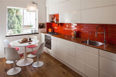 bright orange backsplash in the kitchen decoist