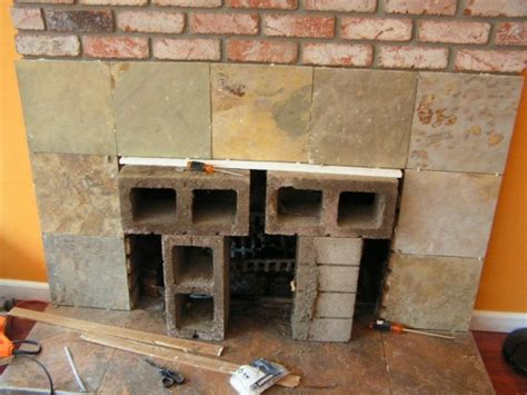 placing slate tiles over the old brick with mortar and