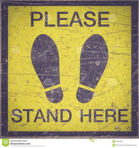 Stand Here by Stand Here Foot Sign Or Symbol On The Floor Stock
