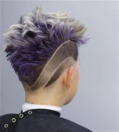 mohawk with designs on the side classic mohawk type burstie fade with three lines and a