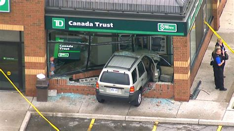 dt bank news injured after suv crashes through bank in
