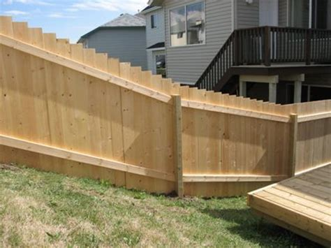 building a backyard fence building fence on a slope with panels help please building construction diy