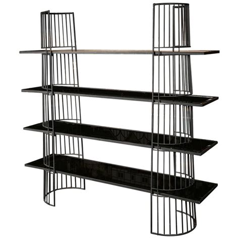 simple curved black metal shelving with black mirrored