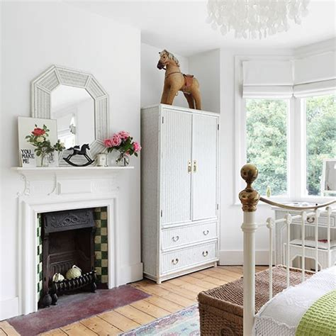 white bedroom with traditional fireplace white bedroom