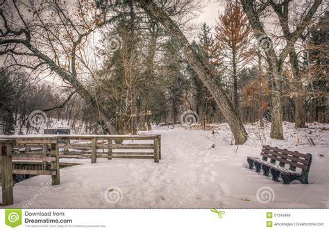 park bench scene winter scene at a park in wisconsin with a vacant park bench editorial stock photo
