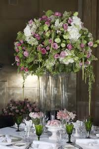 An english style centerpiece of pink and green with hanging green