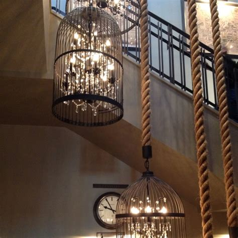 how to hang lights inside chandelier inside bird cage with an awesome rope hanging it seen at restoration hardware ohhhh