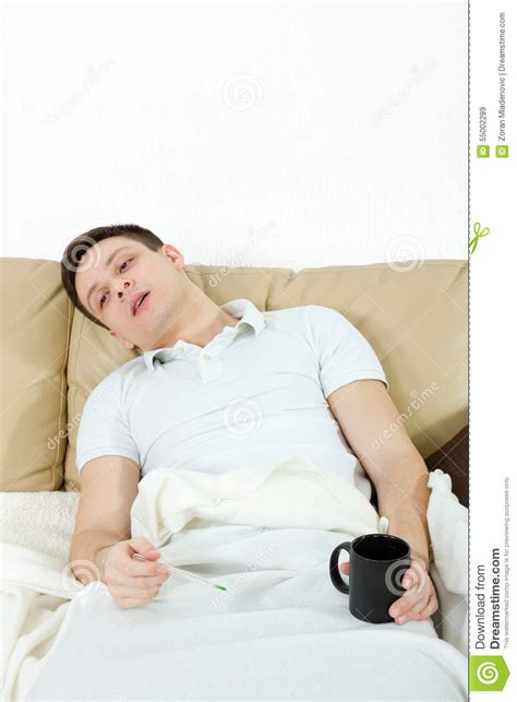man laying in bed dramatic image of sick man laying in bed with fever stock