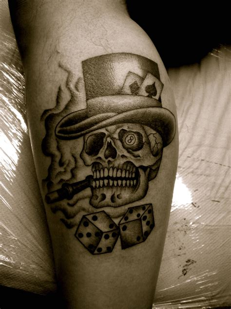 grey ink dice and smoking skull gambling tattoo on leg