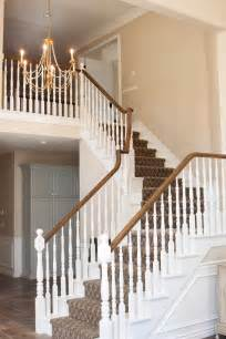After painted white stairs and banister legs darker stained railing