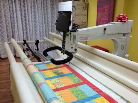 Apqs Giveaway - longarm giveaway winner uses freddie to make quilts for veterans apqs