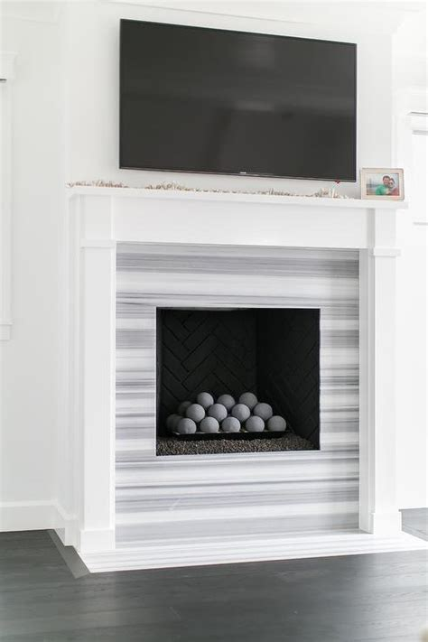 black and white fireplace chevron fireplace surround transitional living room