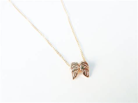 tiny gold angel wings necklace on storenvy