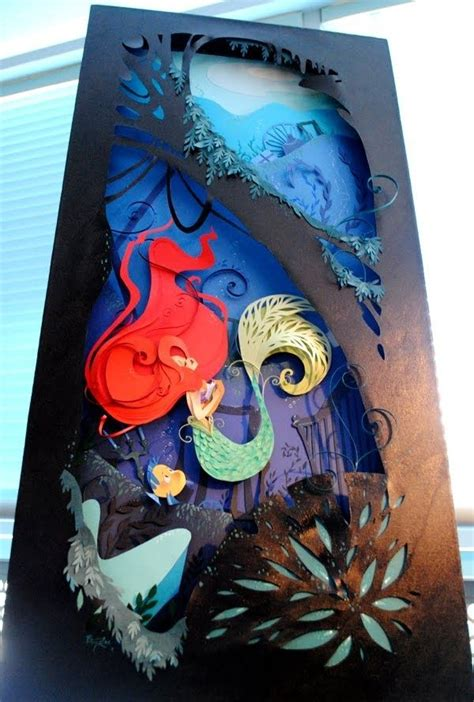 Paper Craft Artists - paper cut out using paper to create sculpture like