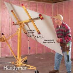 how to hang sheetrock on ceiling by yourself how to hang drywall use a lift the family handyman