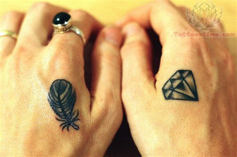 feather tattoo side of hand diamond tattoo images designs