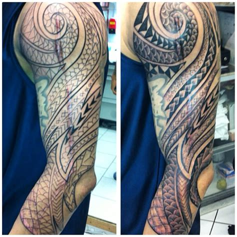 Tattoo Cover Up Oahu | custom polynesian tribal coverup sleeve tattoo done by