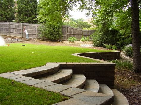 how to level a sloped backyard retaining wall traditional landscape dc metro by