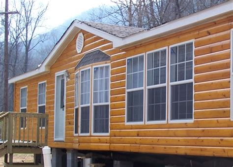faux log siding on log siding log cabin