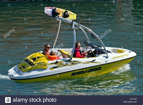 ski doo jet boat family out in ski boat enjoying themselves in bombardier