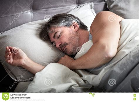 man sleeping in bed man sleeping in bed stock photo image 78651131