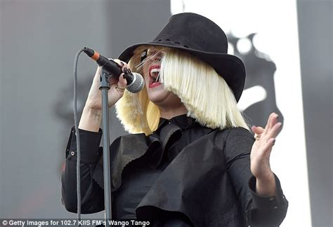 Bobba Black Alive Arts sia furler is spotted putting on hairpiece at wango festival daily mail