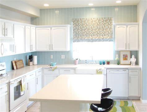 white cabinet and frosted cabinet doors kitchen backsplash