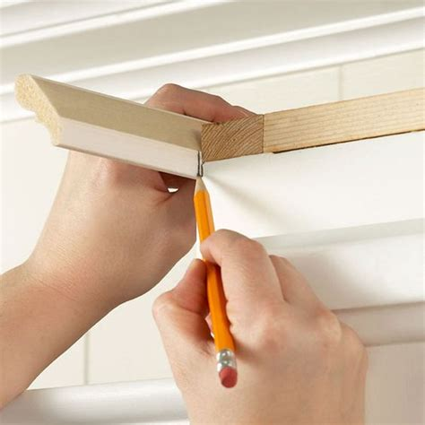 install crown molding on kitchen cabinets the o jays installing kitchen cabinets and wells on pinterest