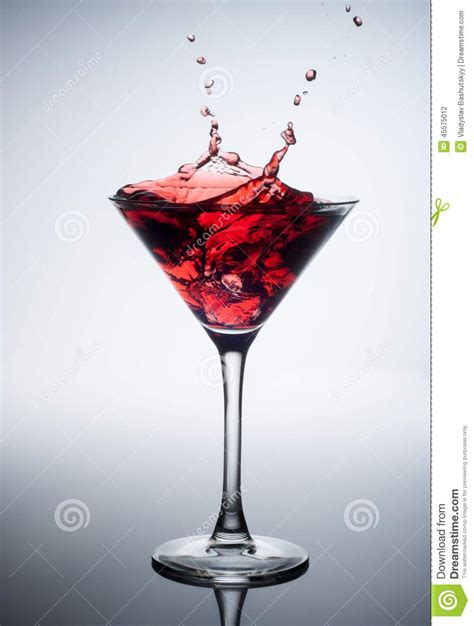 red martini splash red cocktail with splash on white stock photo image