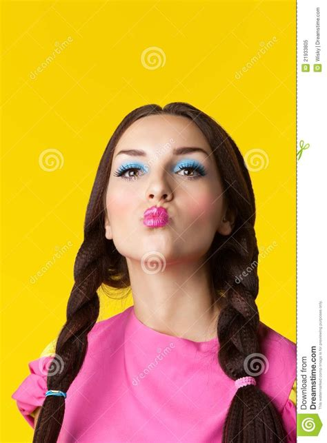 up doll images with make up in doll costume stock image