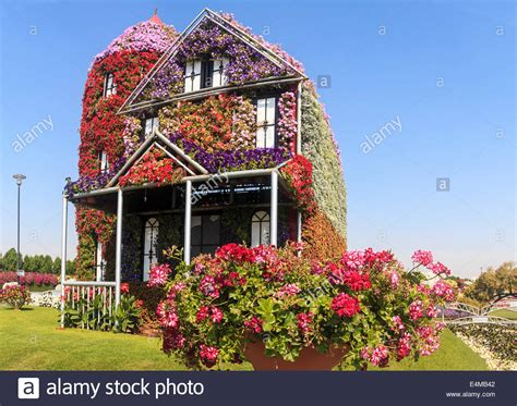 house covered  flowers  dubais miracle garden