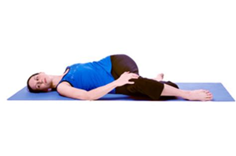 reclined spinal twist how to do reclined spinal twist in yoga