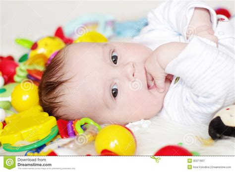 baby 4 months royalty free lovely four months baby among toys royalty free stock photography image 35377837