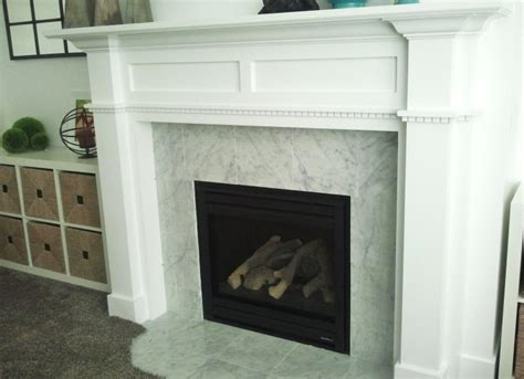 electric fireplace surround at black marble mantel panel