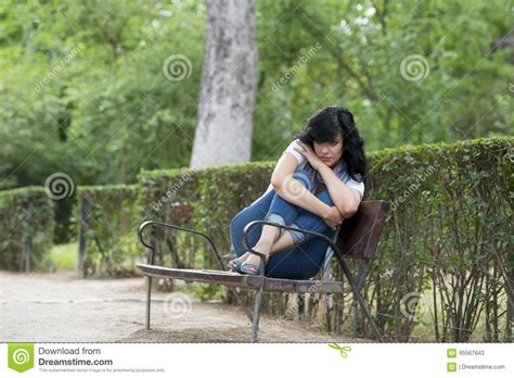 bench latin attractive beautiful latin woman feeling sad and depressed
