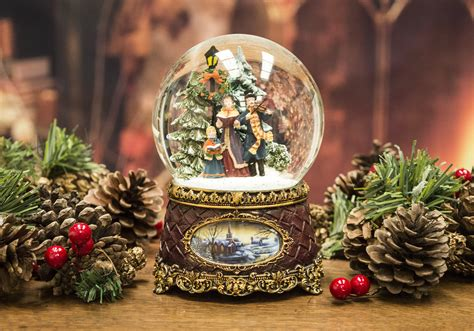 traditional christmas snowglobes snow globe carol singers musical santa claus the book of secrets