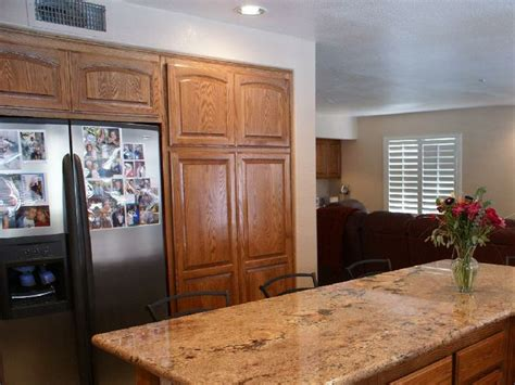 granite countertops with oak cabinets oak cabinets with granite countertops golden oak cabinets