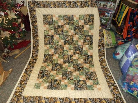 Camo Patchwork Quilt - patchwork quilt of wildlife print camouflage and