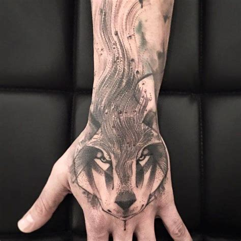 tattoo left hand zeist sketch work style wolf tattoo on the left hand tattoo