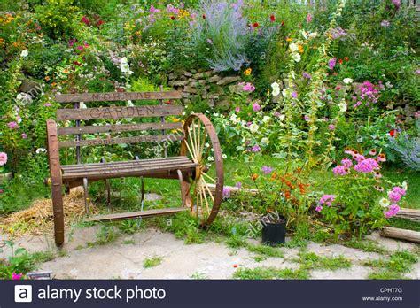 flower bench bench in flower garden stock photo toa55 18608541