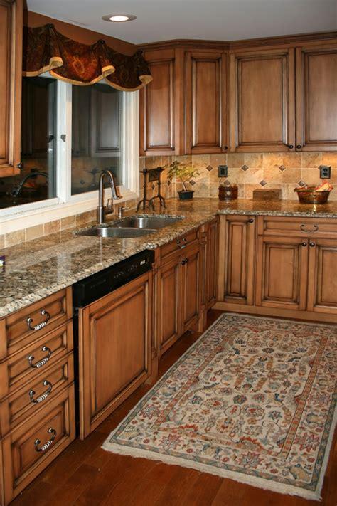 Cream colored kitchen cabinets, brick backsplashes for