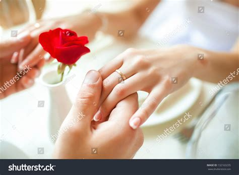 Wedding Holding by Newly Married Holding Rings Stock Photo