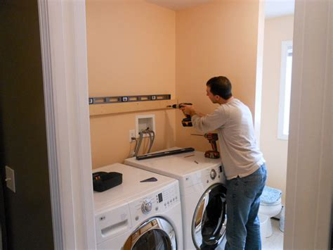 laundry room wall cabinets tips for hanging wall cabinets projects by zac
