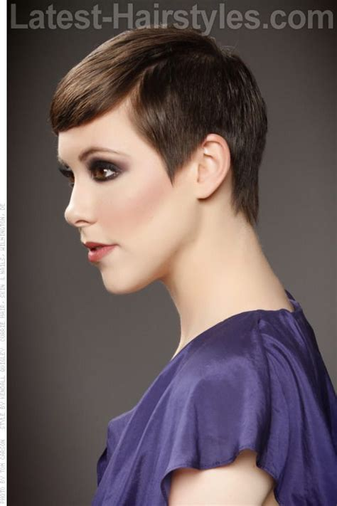 very short haircuts that lay flat to the head polished smooth pixie cut hair is combed forward and